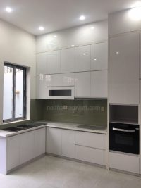 Mẫu tủ bếp gỗ Acrylic An Cường màu trắng thiết kế chữ L sang trọng AC-2076