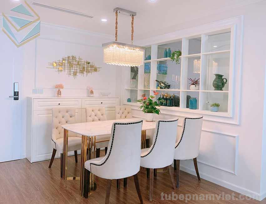 Thiết kế bàn ăn đẹp cùng tông màu trắng với tủ bếp