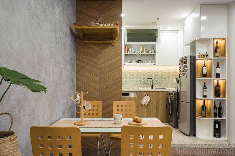 Thiết kế khu vực bàn ăn của phòng bếp gỗ công nghiệp kết hợp tủ rượu đẹp tại căn hộ Vinhomes